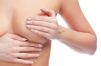 Breast cancer, woman touching her breasts, isolated on white background